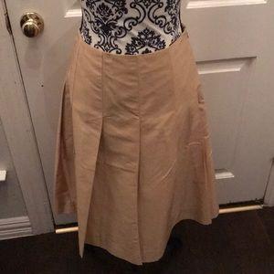 Gold silk skirt.